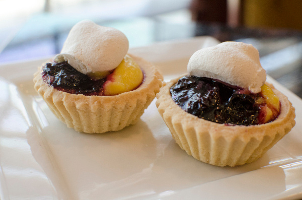 Lemon tarts with blueberry compote topped with cream will be served at the CAN Council Wines Around the World fundraiser on May 29 at the DoubleTree in Bay City.  (Danielle McGrew | The Bay City Times)