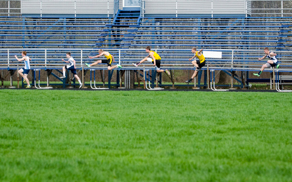 Athletes leap over their first hurdles at the Bay County Track and Field Championships, hosted at John Glenn High School in Bangor Township on Friday, May 9. (Danielle McGrew | The Bay City Times)