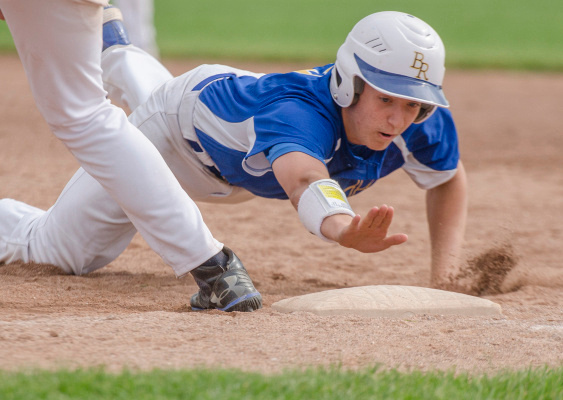 A Birch Run player slides into first base during a district quarterfinal game against Birch Run at Garber High School in Essexville on Tuesday, May 27. (Danielle McGrew | The Bay City Times)