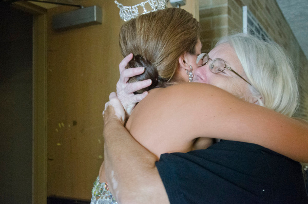 Miss Bay County 2014 Katelyn Mlujeak hugs directory Linda Bilhimer before going onstage for the Miss Bay County pageant on Sunday, July 20, at Garber High School in Essexville. (Danielle McGrew | for the Bay City Times)