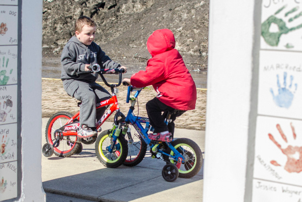 Greydon Thomas, almost 5, honks his bicycle horn at his friend Owen Olepsy, 5, at a playground in Veterans Memorial Park in Bay City on Wednesday, April 2. (Danielle McGrew | The Bay City Times)