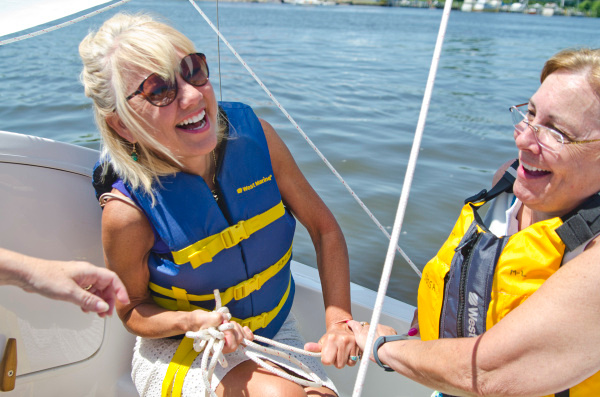 Patsy Aguilera of Bay City and Mary Mahony of Libertyville, Ill., laugh as they try to adjust a sail during the annual Try Sailing Day event hosted by the Saginaw Bay Community Sailing Association on Saturday, June 14, along the Saginaw River