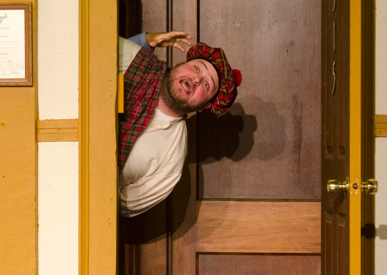 """Bob Graczyk (Todd the Scotsman) yells the final line of the play during a rehearsal of """"Unnecessary Farce"""" at the Whistling Idiots Theatre Tuesday, May 13. (Danielle McGrew 