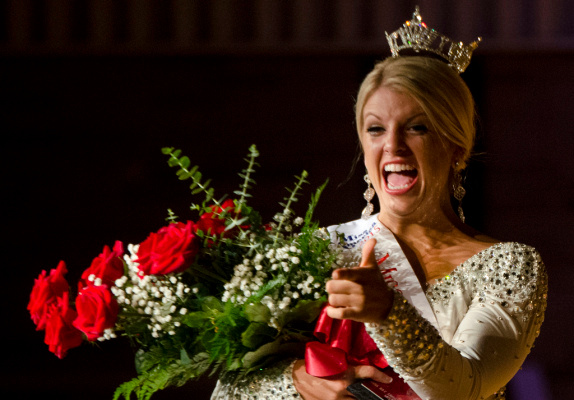 Mallory Rivard reacts to someone in the crowd as she waves after being crowned Miss Bay County 2015 on Sunday, July 20, at Garber High School in Essexville. Rivard will compete in the Miss Michigan pageant as part of the Miss America program next year. (Danielle McGrew | for the Bay City Times)
