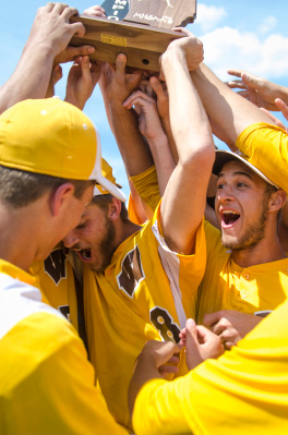 The Bay City Western Warriors react to winning the Division 1 regional finals against Flushing at Saginaw Valley State University on Saturday, June 7. The Warriors will proceed to the quarterfinal game at Central Michigan University on June 10. (Danielle McGrew | The Bay City Times)