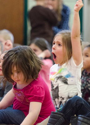 """Pre-kindergarten student Skyla Green-Sweeney is extremely excited about the  """"Jump with Jill"""" rock 'n' roll nutrition show at MacGregor Elementary School in Bay City on Tuesday, March 18. (Danielle McGrew 