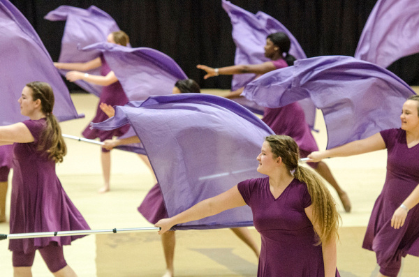 "Summit Academy Color Guard from Romulus, Mich., performs ""We Are Home"" during the Michigan Color Guard Circuit championships at Saginaw Valley State University Ryder Center on Saturday, March 29. Summit Academy placed third in the Regional A Division. (Danielle McGrew 