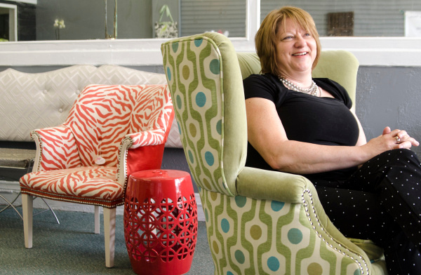Victoria Trischler sits in a chair reupholstered with velvet in her downtown Bay City shop, Super Chic Designs on Tuesday, June 3. (Danielle McGrew   The Bay City Times)