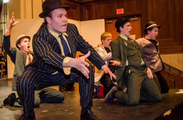 """Sky Masterson, played by Logan Rabideau, and other gamblers rehearse """"Luck be a Lady Tonight"""" from Guys and Dolls at Bay City Central High School on Tuesday, March 11. (Danielle McGrew 