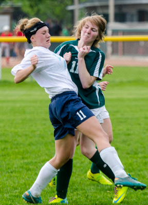 Garber freshman Molly Ledesma and Clare junior Kyra Pappas collide during a district quarterfinal game at Viola Verellen Elementary School in Hampton Township on Tuesday, May 27. (Danielle McGrew | The Bay City Times)