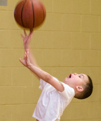Amon Laudenslager, 6, shoots a basketball at the Bay County Community Center in Bay City on Tuesday, March 4. Amon was at the gym during open basketball with his stepfather, Ronnie Wilkins of Bay City. (Danielle McGrew | The Bay City Times)