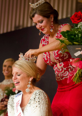 Mallory Rivard reacts as she is crowned Miss Bay County 2015 by Miss Bay County 2014 Katelyn Mlujeak  on Sunday, July 20, at Garber High School in Essexville. Rivard will compete in the Miss Michigan pageant as part of the Miss America program next year. (Danielle McGrew | for the Bay City Times)