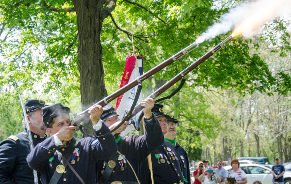 Sons of Union Veterans of the Civil War members Lloyd Lamphere and Jack Frost fire rifles to salute fallen soldiers and veterans during a rededication ceremony on Memorial Day, May 26. The former Pine Ridge Cemetery was renamed Soldiers