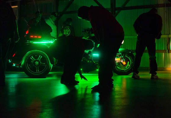 Judges examine a motorcycle during light competition at the Gold Wing Road Riders Association Rally at the Midland County Fairgrounds on Saturday, Aug. 2. The three-day event includes several competitions, entertainment and motorcycle rides.