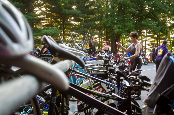 Danielle McGrew | for the Daily News Athletes prepare their gear for the biking segment of the Sanford and Sun Triathlon and Duathlon at Sanford Lake Park on Saturday, Aug. 9. The competition raises funds for the Fallen and Wounded Soldier Foundation.